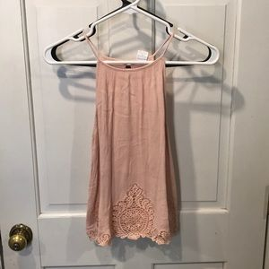 Pale pink halter tank top with lace detail. Size M